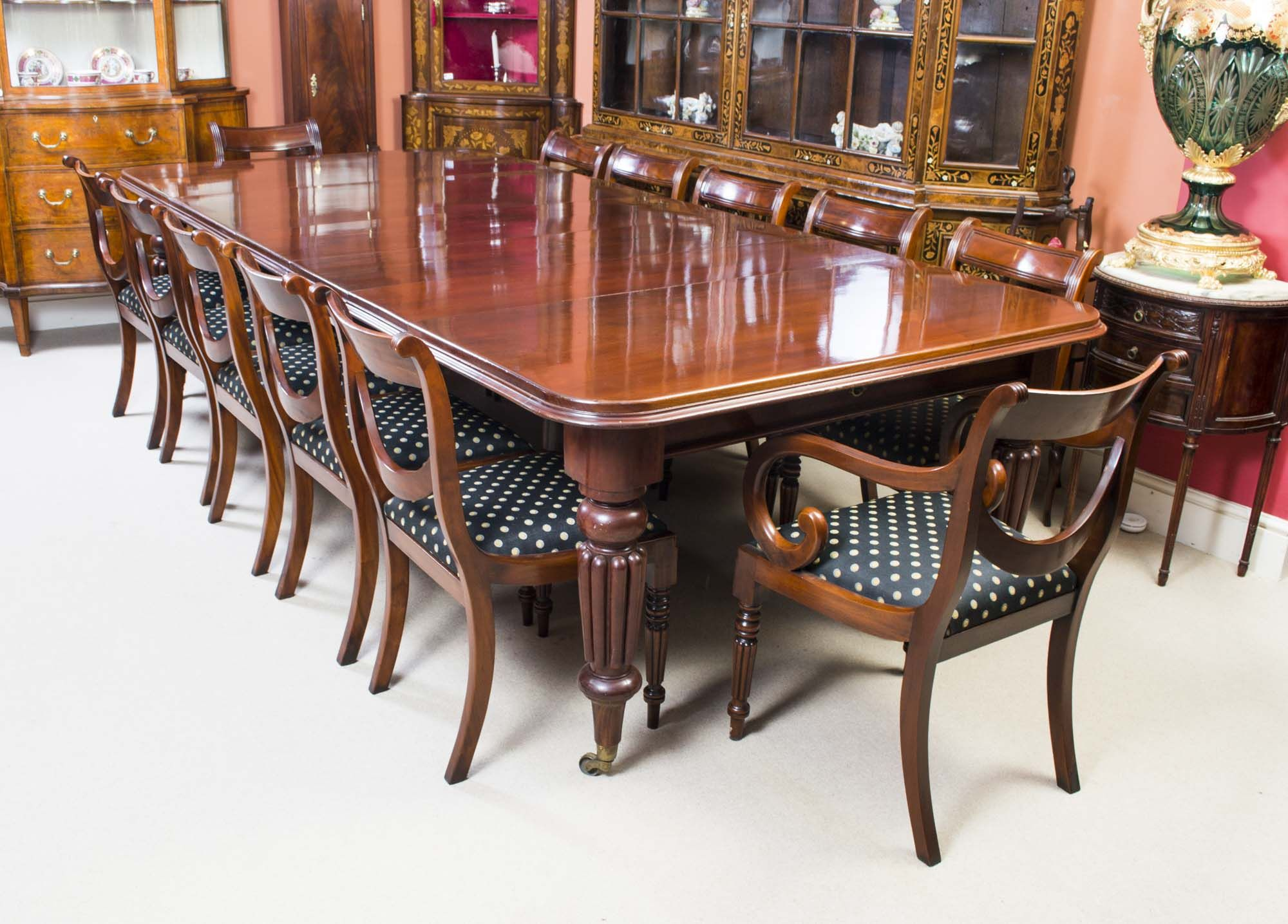 An antique Victorian dining table and chair set fit for a queen