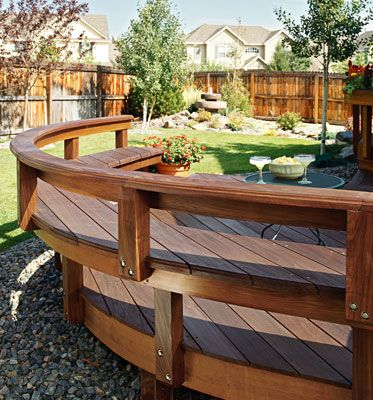 A deck with built in seating around the edge of the deck coffee