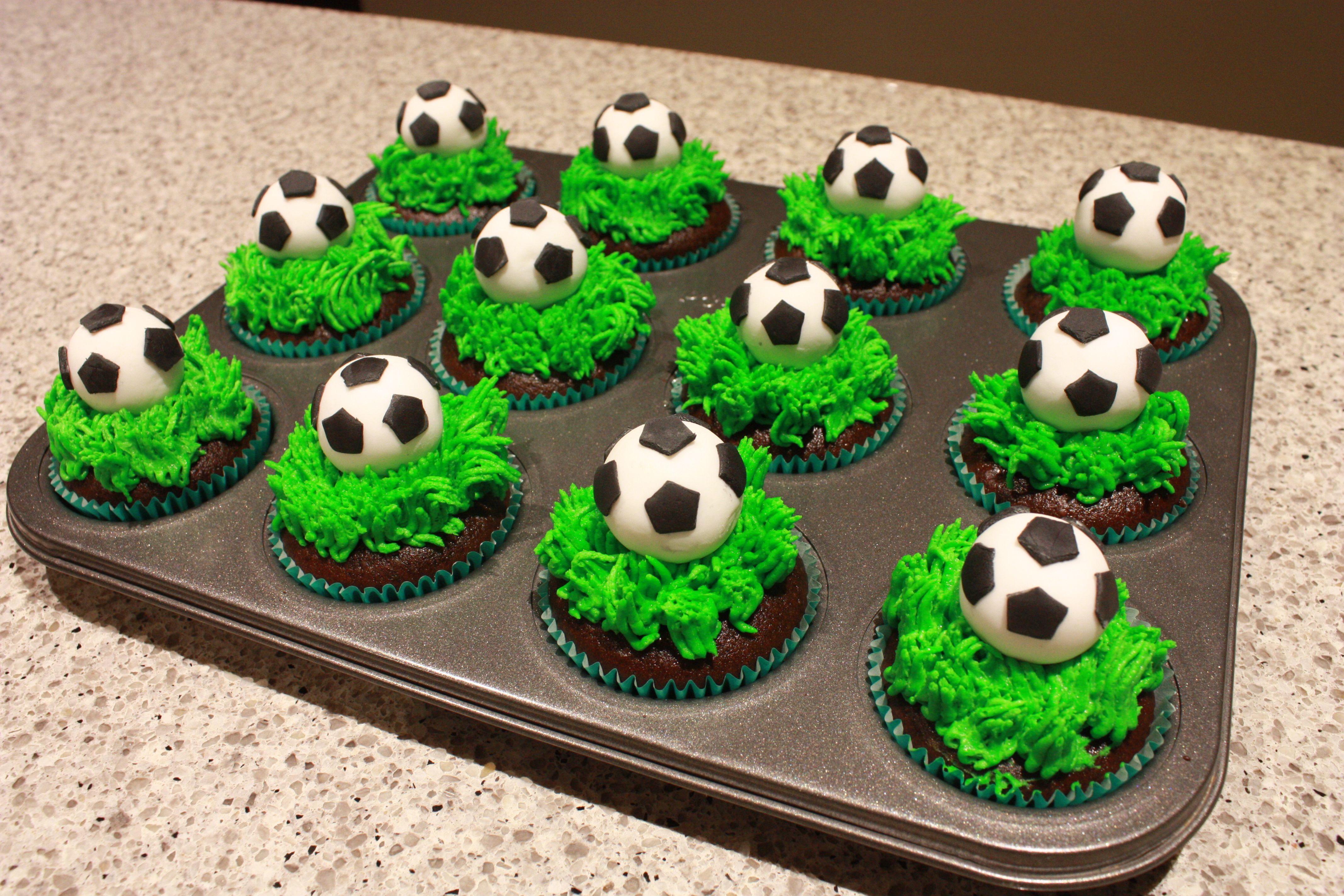 Soccer Ball Cupcakes Chocolate Cupcakes With Buttercream Grass And Handmade Fondant Soccer Balls Soccer Ball Cake Soccer Cupcakes Cake Design