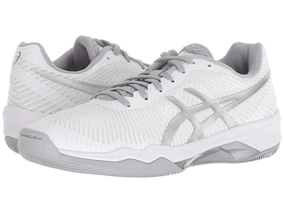 ASICS Volley Elite FF (White/Silver) Women's Volleyball Shoes. Own your game with the supportive and responsiveness of the Volley Elite FF. Breathable open mesh uppers in a sporty silhouette. Reinforcing synthetic overlays. Easy lace-up closure. Plush tongue and collar. Breathable textile linings. Offers superior bounce and responsiveness with FLYTEFOAM; designed with organic fibers that reduce packing out  commonly associated #ASICS #Shoes #Athletic #Volleyball #White