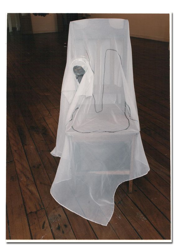 Vanessa Carneiro Kindt - Installation - Needle work, print, printed paper, glass, thread and neddle on cloth. Wooden chair.  foto: Tibério França