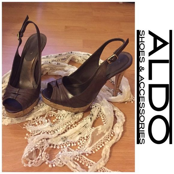 ✨WEEKEND SALE✨ ALDO shoes don't just like it .... send me an offer and I'm happy to negotiate   ALDO shoes. Size 6. Brown leather with wood-like bottom. Straps in the back. There are minor scrapes in the front left shoe and seen in pictures. Besides that, shows in excellent condition. ALDO Shoes Heels