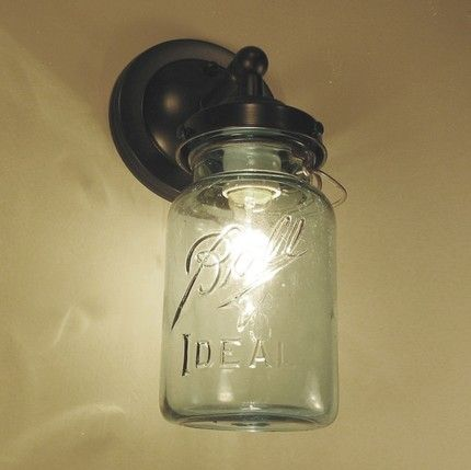 vintage blue canning jar sconce 69 bucks on Etsy...I wonder if this would a Great Mason Jar would Fit on MY Porch Light...Have to try it.