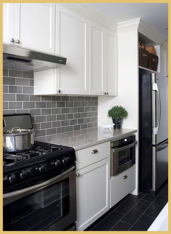 Pros And Cons Of Stainless Steel Backsplash Kitchen Decor Tips In 2020 White Modern Kitchen Modern White Kitchen Cabinets Kitchen Backsplash Tile Designs