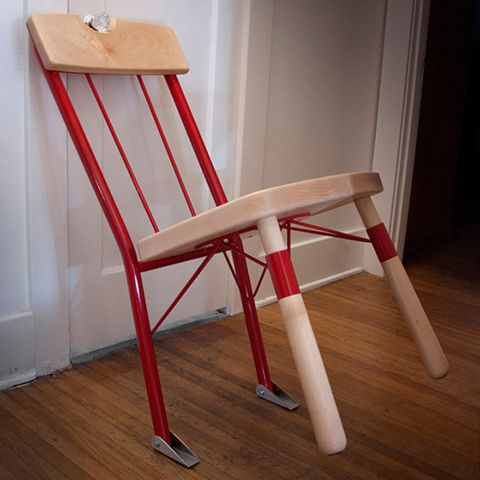"""""""The back of the chair's made from steel tubing so it's extra strong, while a pair of gripped pivoting feet on the back legs help keep it in place. There's even a notch in the backrest designed to perfectly fit a doorknob so the chair stays in place long enough for you to slip out the window and safely jump five stories into a dumpster full of cushioning boxes and trash bags below—just like in the movies."""""""