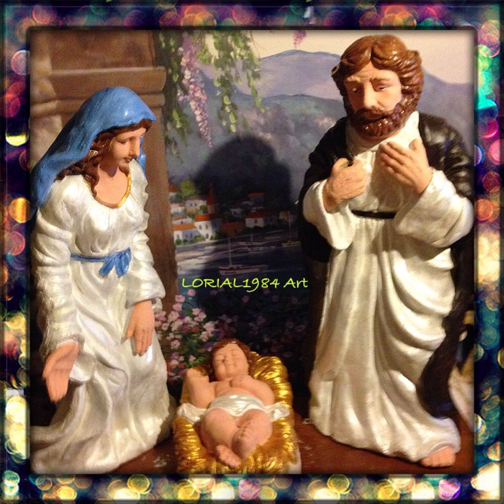 Painted statues of Virgin Mary, St. Joseph, and Baby Jesus
