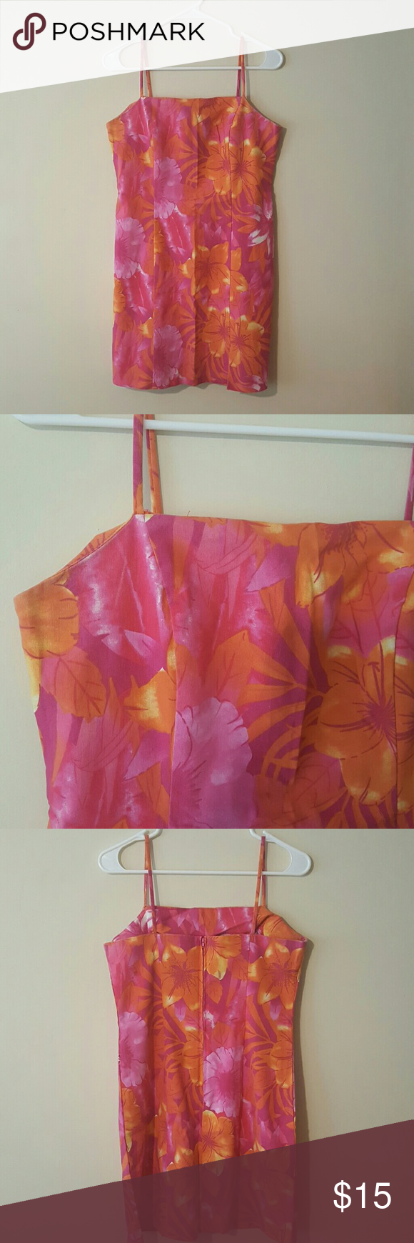 """City Triangle Spaghetti Strap Sundress Floral motif in shades of pink, white, orange and magenta stretchy, zipper backed Sundress. With spaghetti straps. Excellent condition. Mid length with sexy slit above right hem.  28"""" from chest to bottom hem 16.5"""" from armpit to armpit  16.25"""" waist 19"""" across hip area Dresses Midi"""