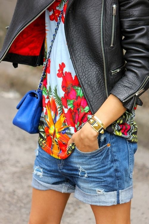 Black leather jacket, powder blue floral print blouse, torn & faded blue jean shorts.  A cute outfit for regular daily wear & fun street wear.