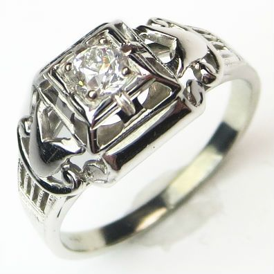Nifty Retro Ring: There is an almost theatrical feel to the scrolling sides and angular framing, which really set off the brilliant antique diamond. Ca.1938. Maloys.com
