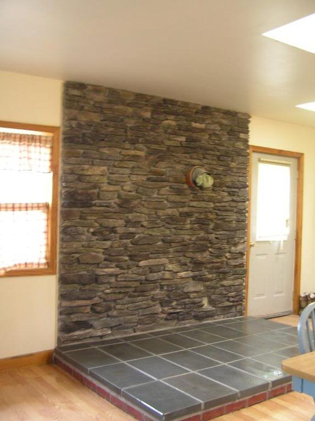 Wood Stoves Can Be A Cost Effective Source Of Household Heat In The Winter.  A Stone Veneer Back Wall Can Offer All Of The Lasting Beauty And Elegance  Of A ...