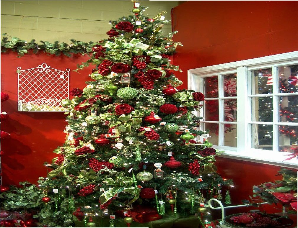 love the bright bold red against the pale green and dark green color of the tree this creation is a delight to see - Red And Green Christmas Tree Decorations
