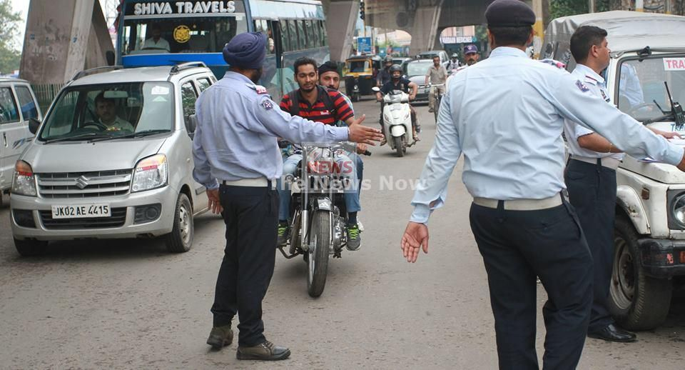 Traffic Police Officers Checking Traffic Violation By Bikers On