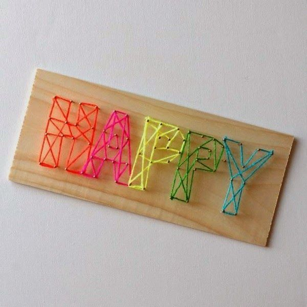 Photo of Make a colorful sign with yarn and nails ~ Mimundomanual