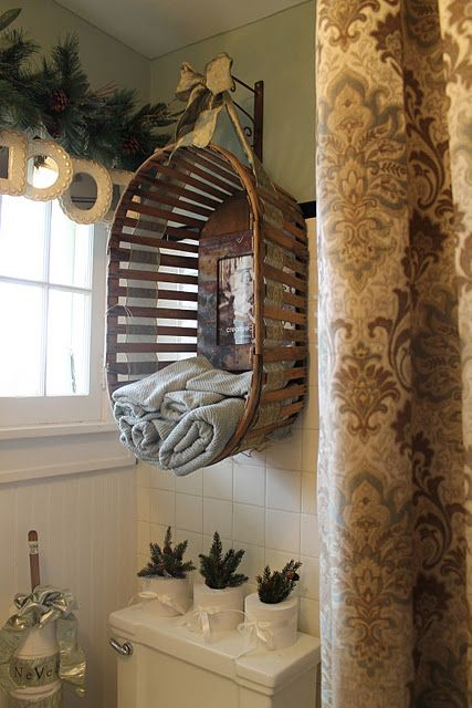 Basket hung as unique bathroom towel storage.- I am not quite sure what to think about this idea yet...going to give it some thought. Very inexpensive compared to larger cabinet style- my concern is the basket giving out due to the weight of towels, misc. Looks cute but is it practical?