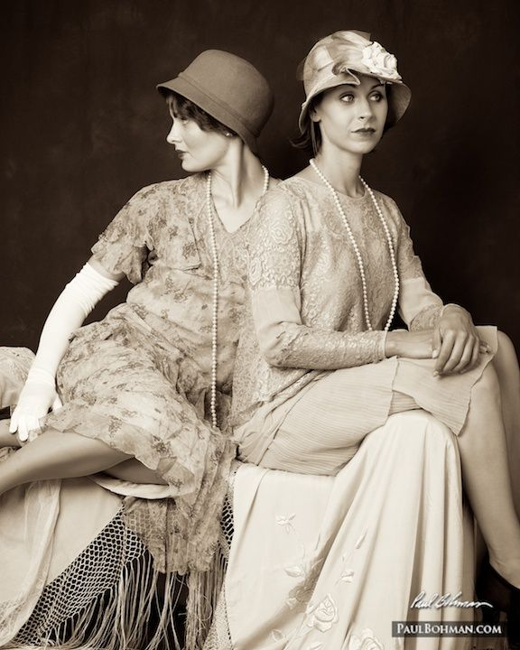 1920s vintage fashion with two women sitting back to back