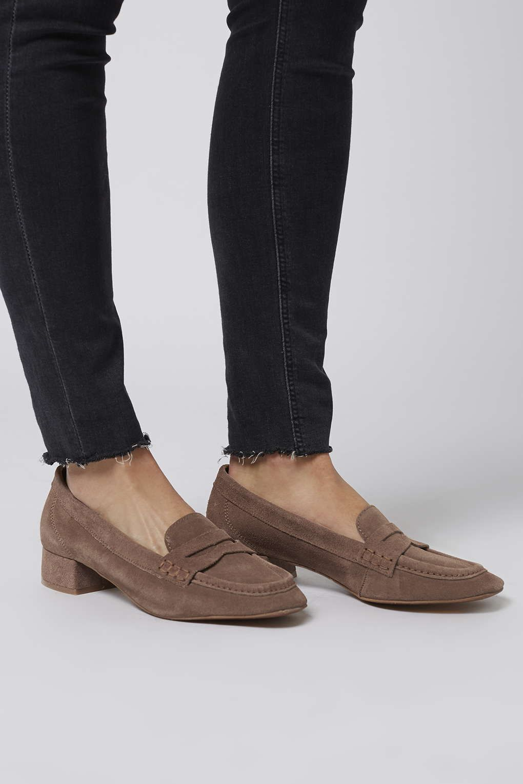 A totally androgynous style comes revamped with these leather suede  loafers. Crafted in a pretty blue, we love the easy style and versatile  block heel.