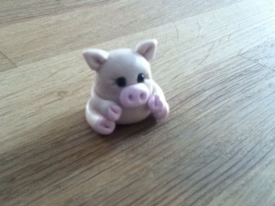 A small pig I made out of polymer clay