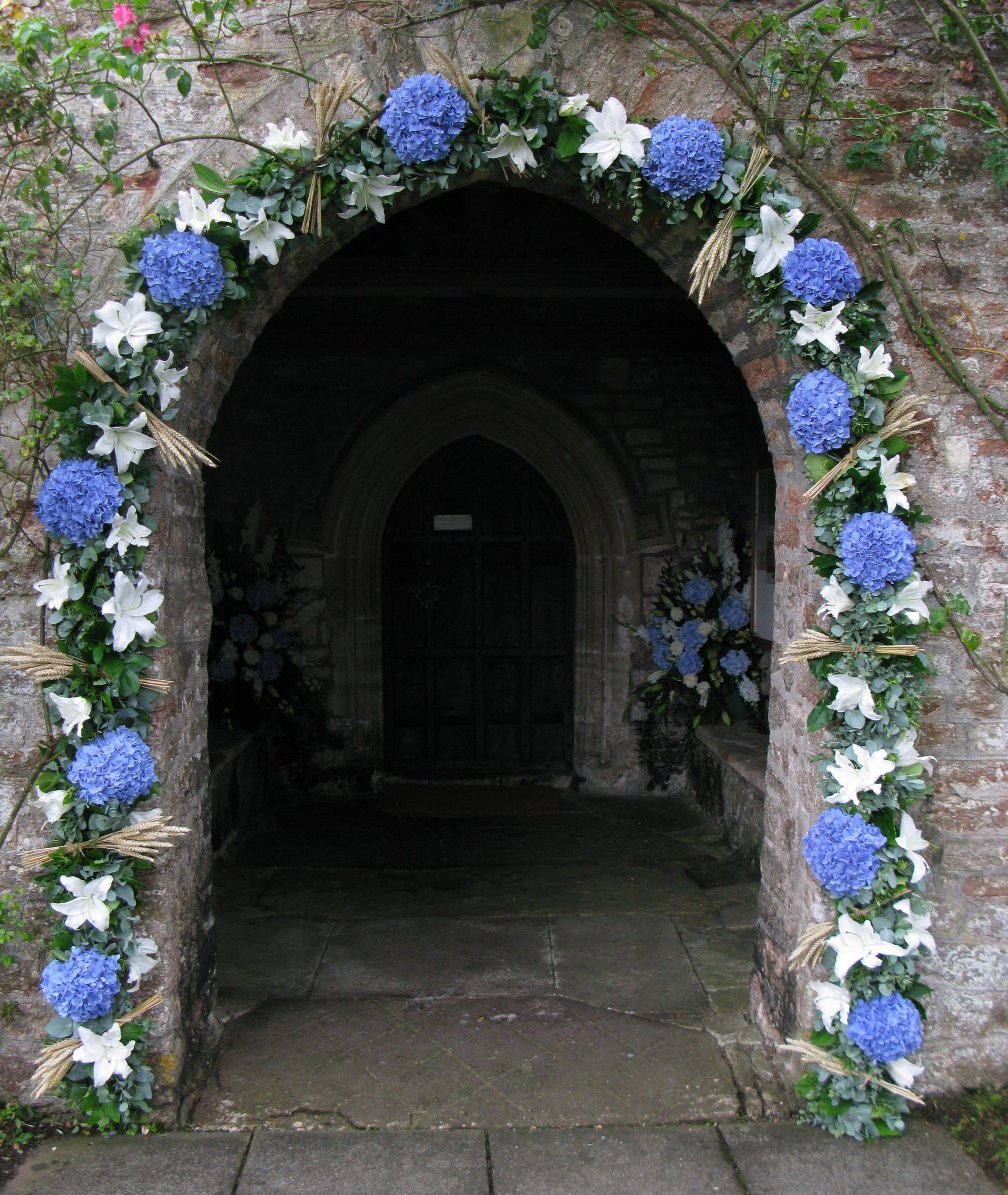 decorated wedding arch the church door can be decorated with a garland of 3347