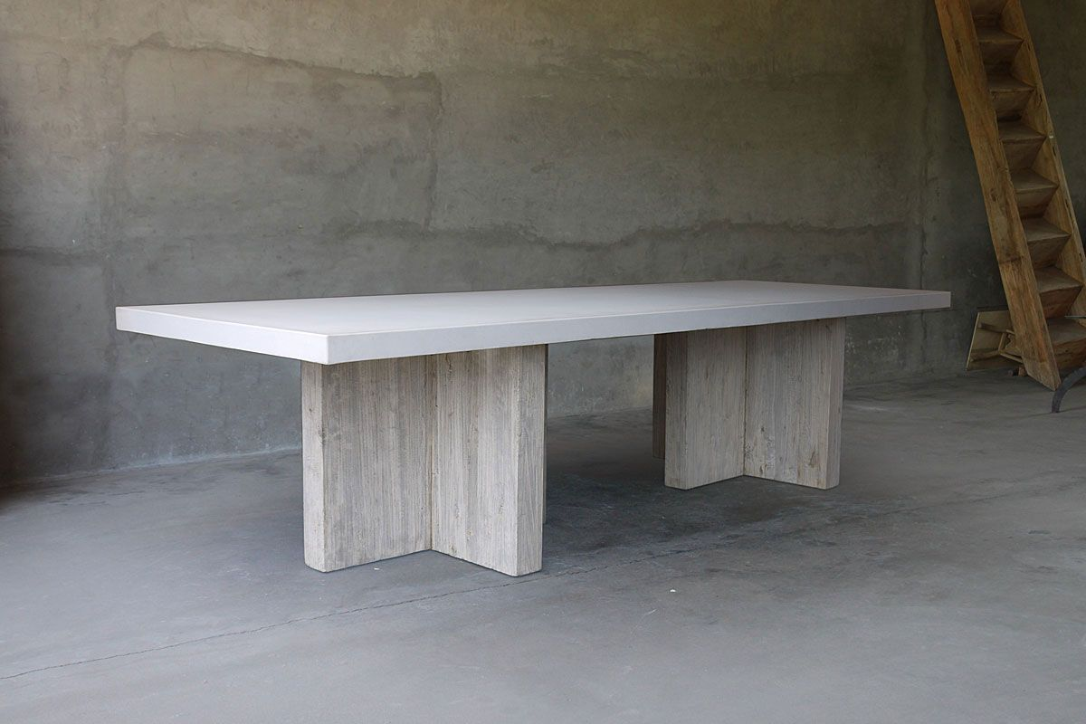 "Rectangular concrete table with reclaimed elm ""t"" bases. This table is not suitable for outdoor use."