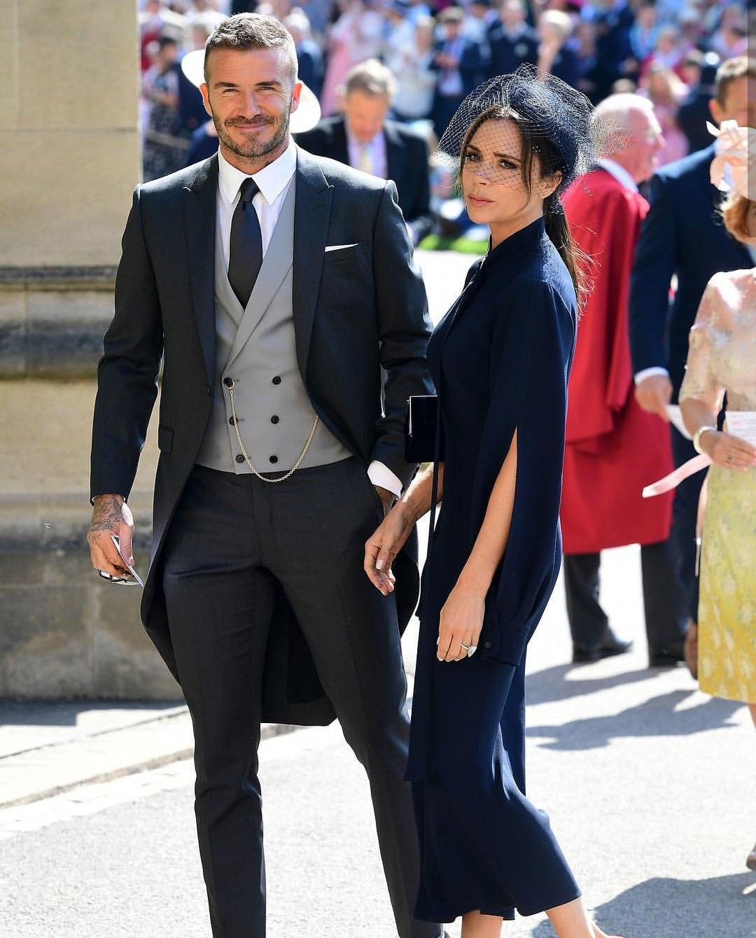 d11b7091a David Beckham in Dior Homme & Victoria Beckham in her own creation at the  royal wedding of Prince Harry & Ms. Meghan Markle.