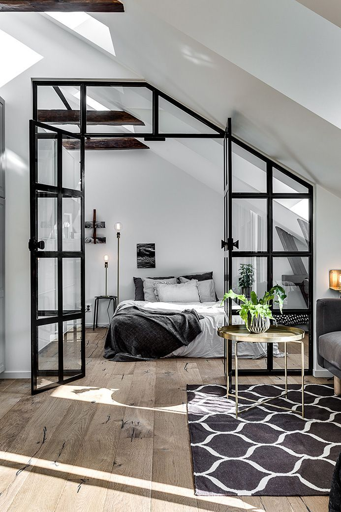 The floors! And love the masculine/contrasting black framed glass wall... Kind of urban industrial but the floors are earthy and rustic.