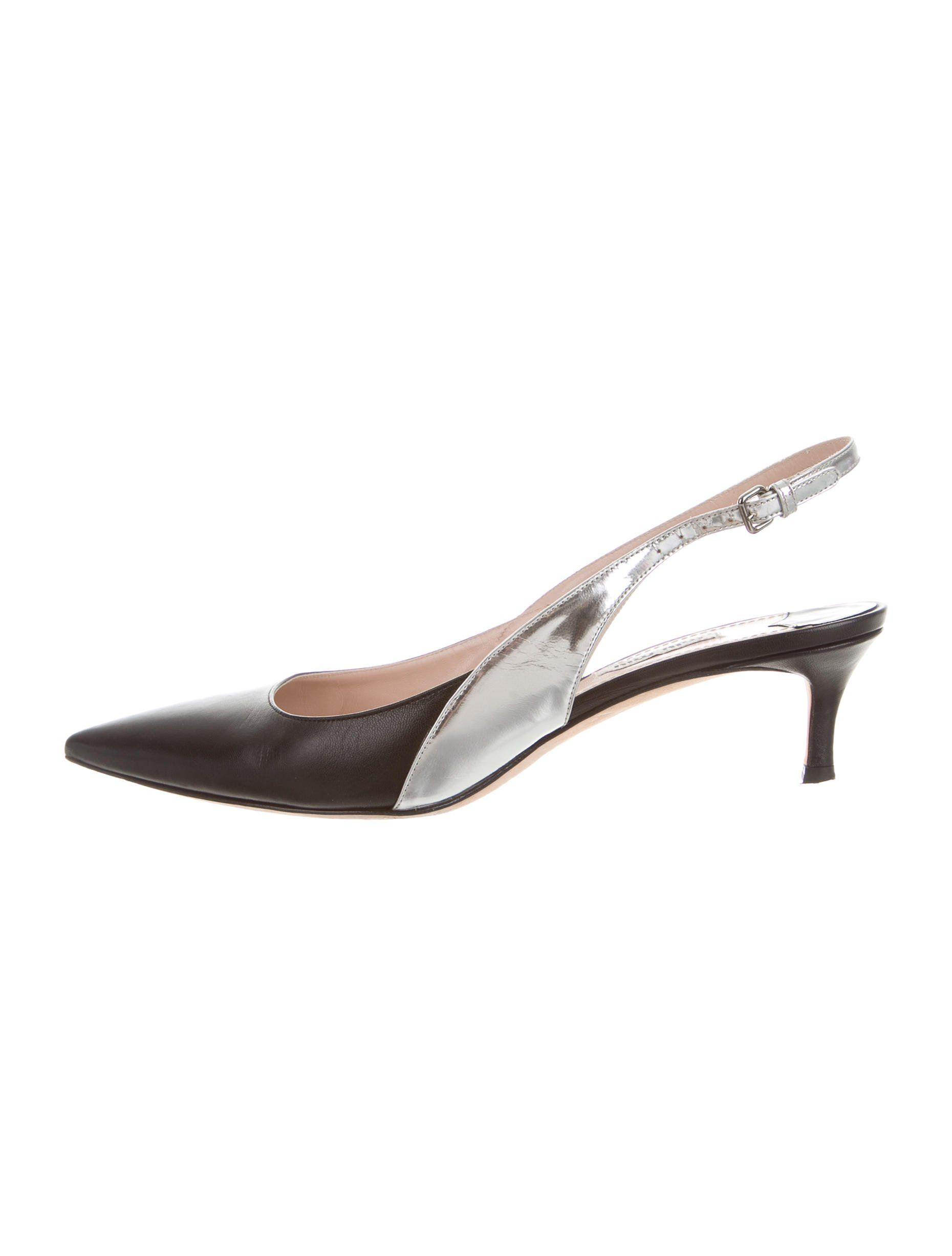 Black and silver leather Miu Miu pointed-toe slingback pumps with covered low heels and buckle closures at ankles.