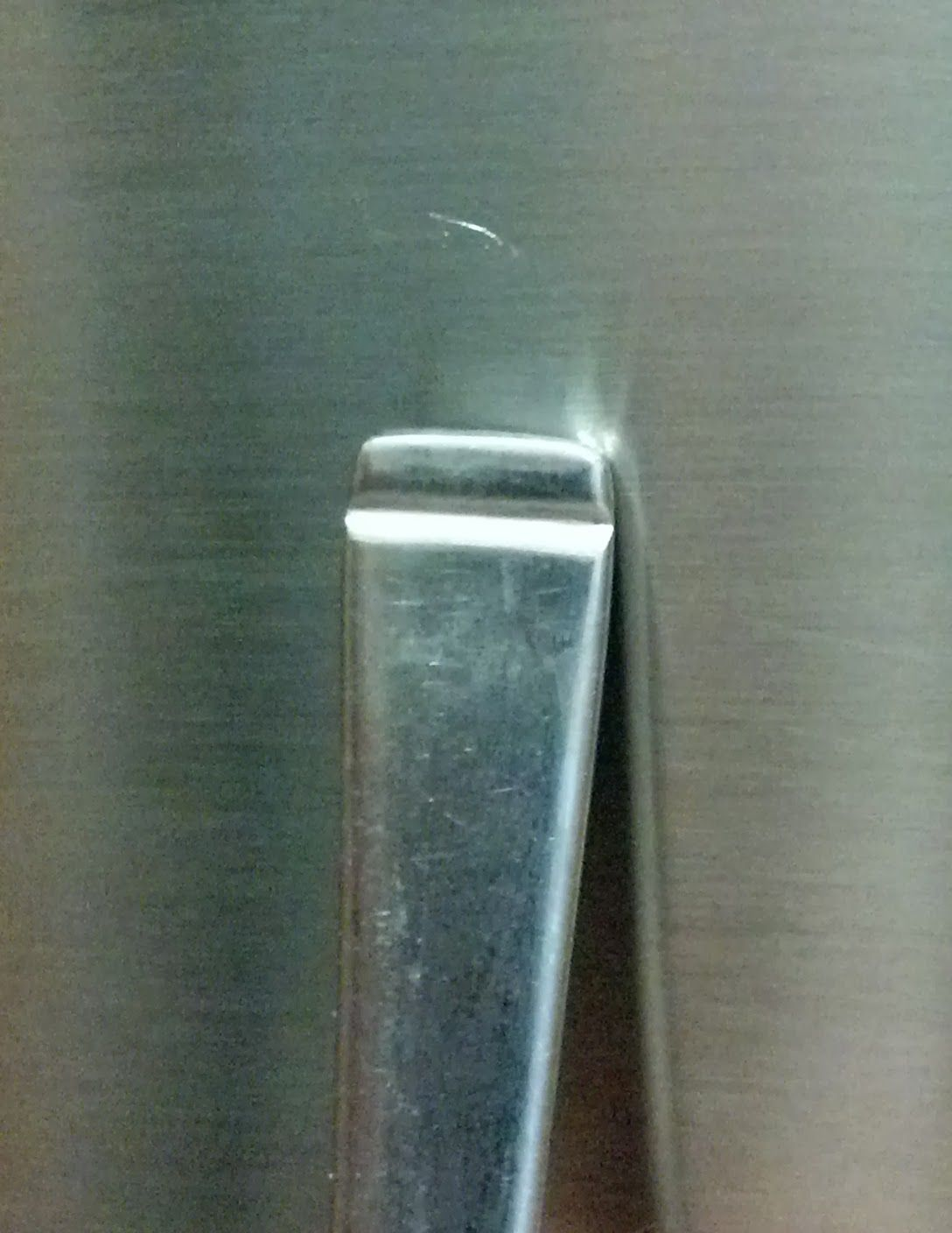 Scratches In Brushed Stainless Steel
