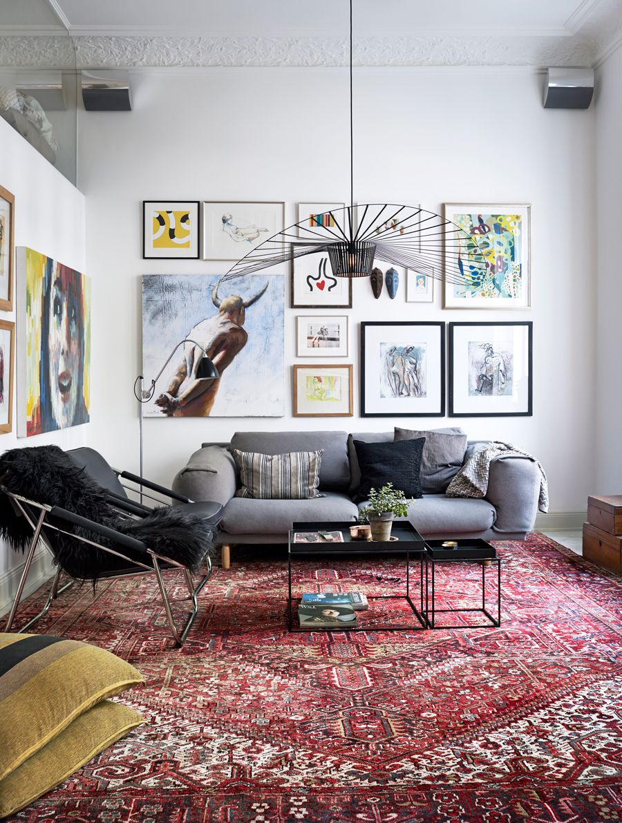 Persian rug gallery wall and gray sofa in scandinavian apartment also