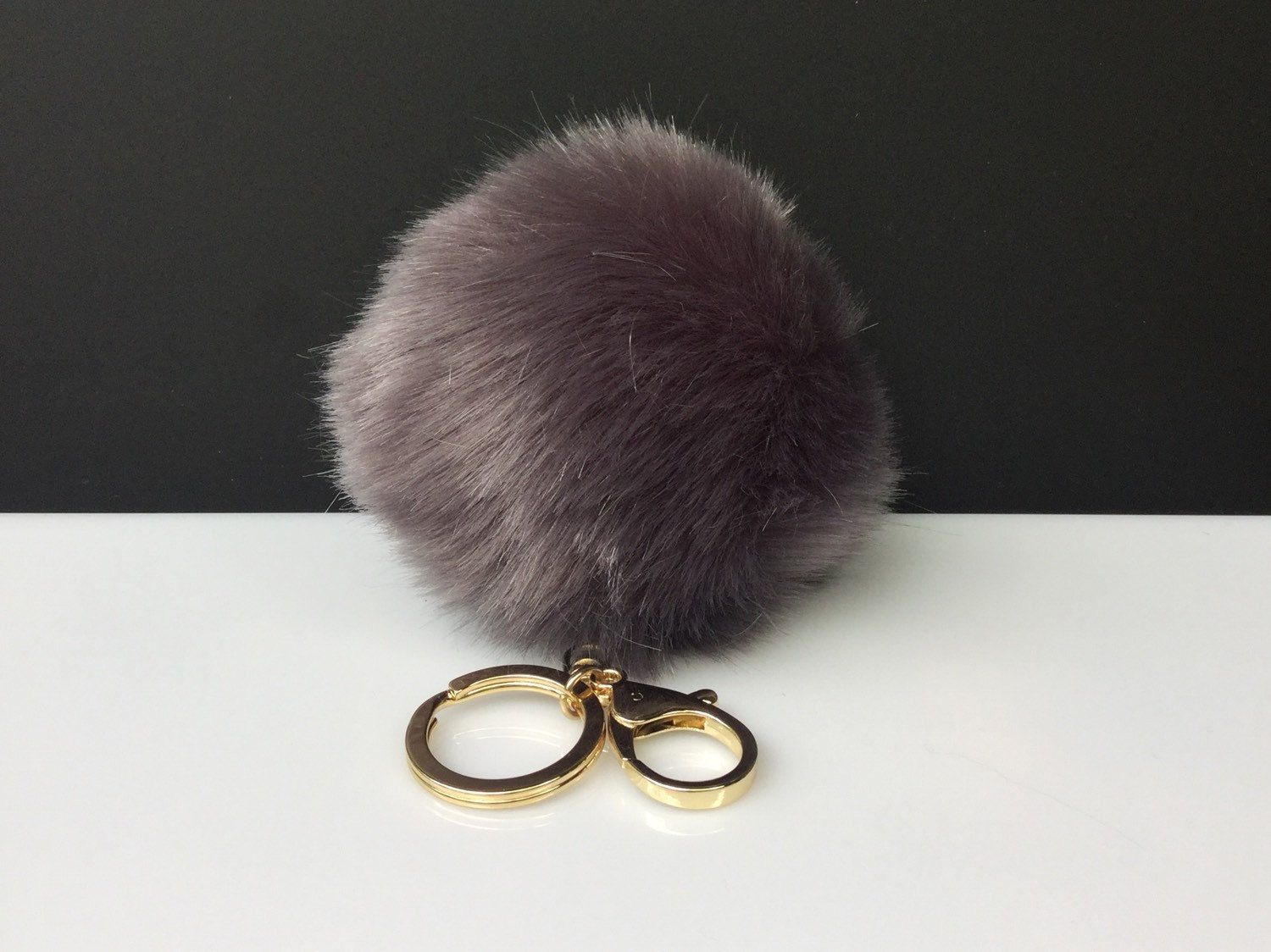 c808c774d7aa Faux Rabbit Fur Pom Pom bag Keyring Hot Couture Novelty keychain pom pom  fake fur ball in dark grey by YogaStudio55 on Etsy