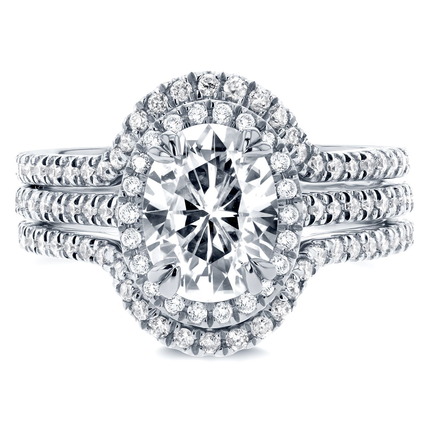 Oval halo 3 piece bridal set featuring a large Forever Classic