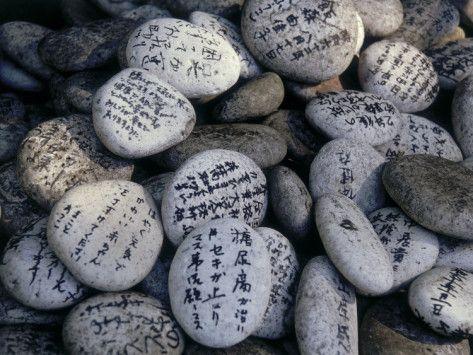 Prayer on Stones at the Feet of a Buddha (Senyu-Ji), Japan.
