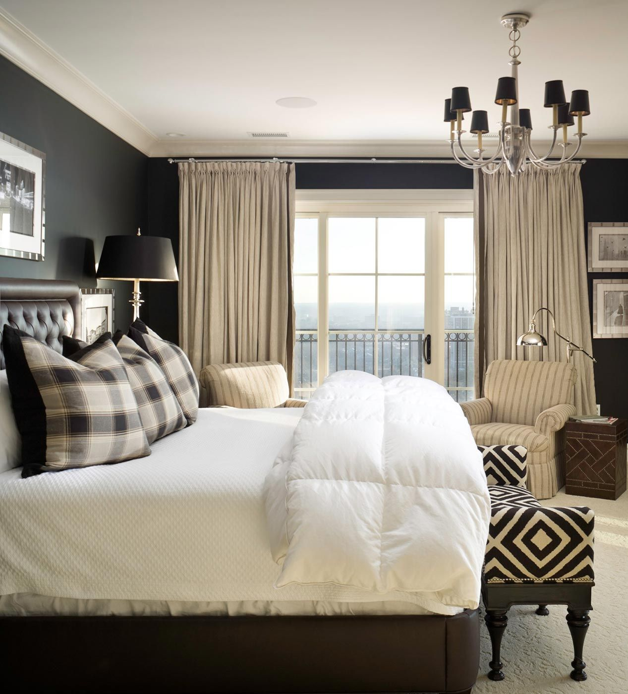 Bedroom With Black Walls White Bedding And Off White Curtains