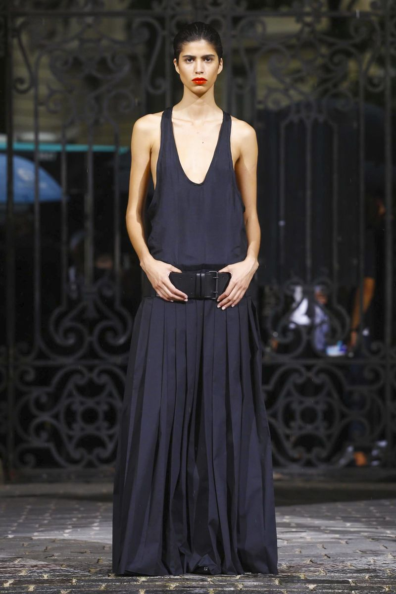 """Haider Ackermann, too, you could clock it in the bold stripes, the tight trousers, and animal print creeper shoes. There was a distinct note of Ziggy Stardust, the ultimate rebel pin-up, goin..."