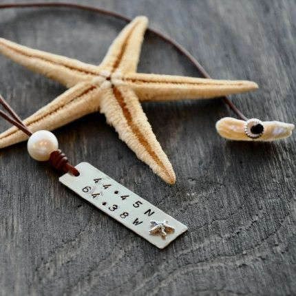 Stamped pendant on leather necklace with pearl and starfish detail