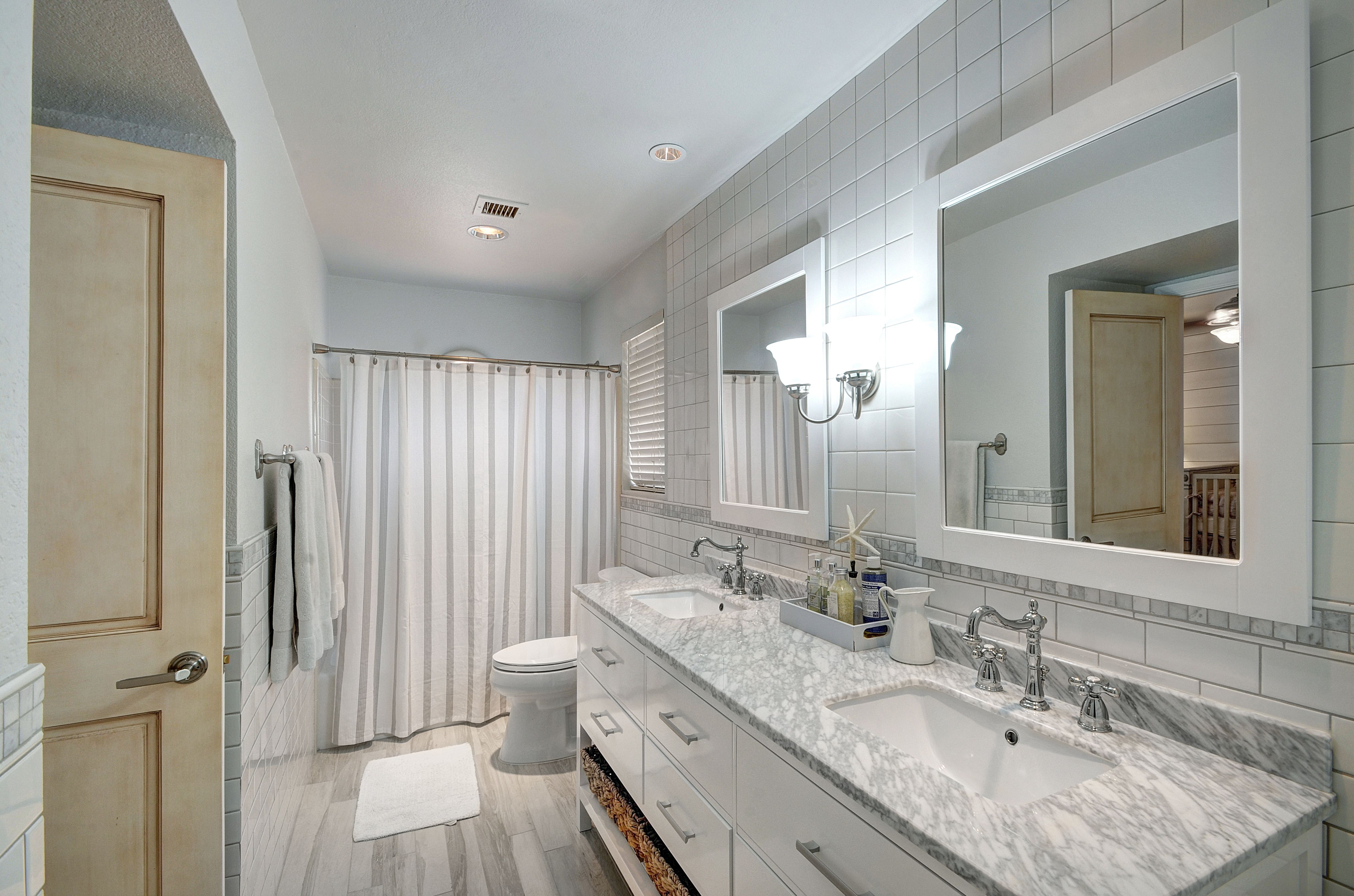 Completely remodeled guest bathrooms. Contemporary white Oak