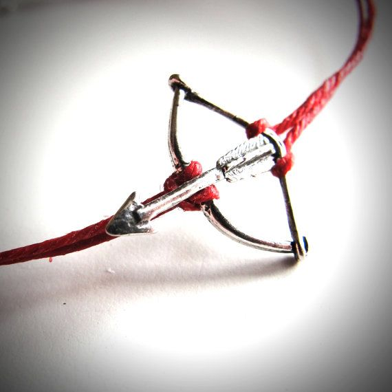 Who loves the Hunger Games? Me too! Katniss bracelet in sterling silver on fire red linen. $18 from JewelryByMaeBee on Etsy.