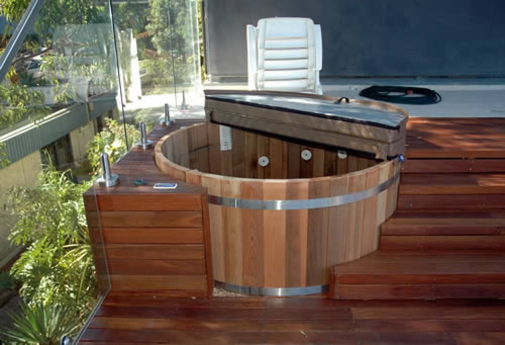 Here 39 s a hot tub deck built custom for a small round 6 for Circular garden decking