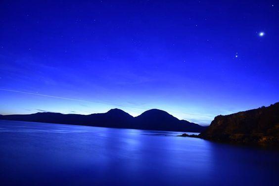 Morning above the Paps of Jura - three mountains on island of Jura, Scotland - by Robin Morton
