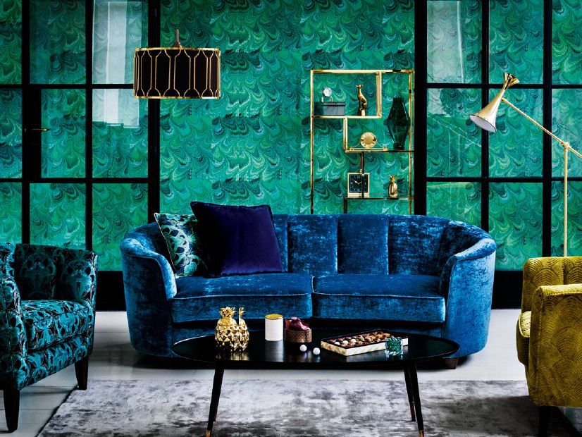A Crushed Velvet Blue Sofa And Green Armchair Perfect For
