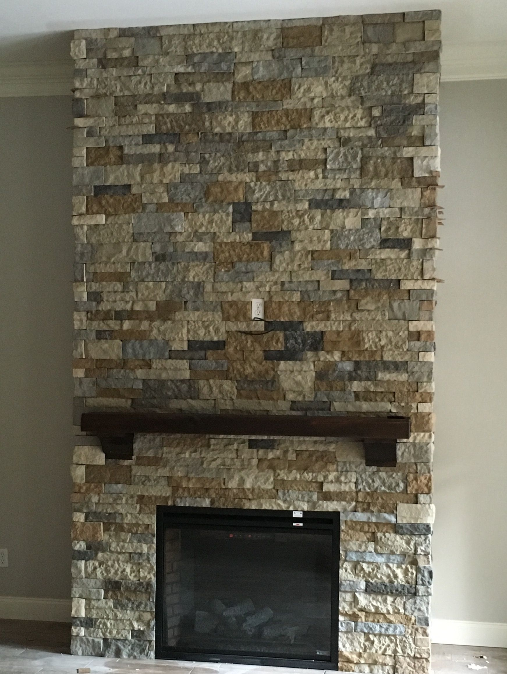 airstone fireplace made with mix of autumn mountain and spring
