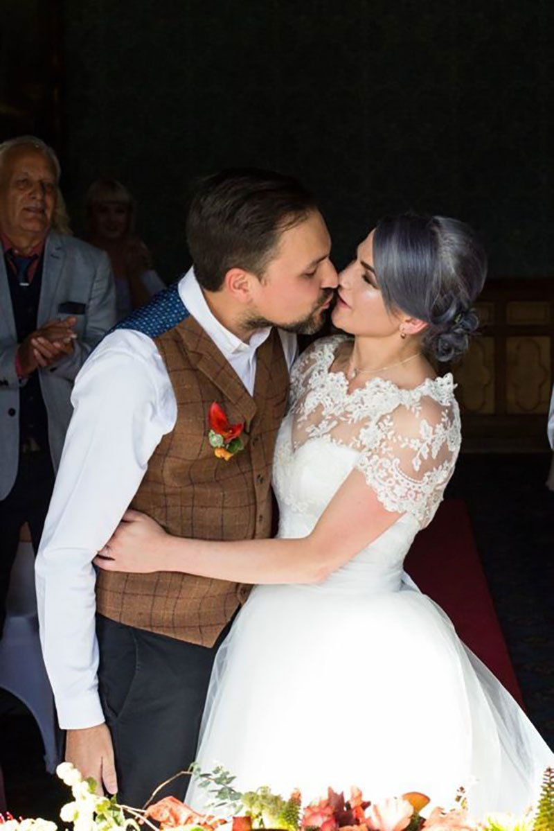 A blue-haired bride and bearded bassist let us bask in their goth wedding