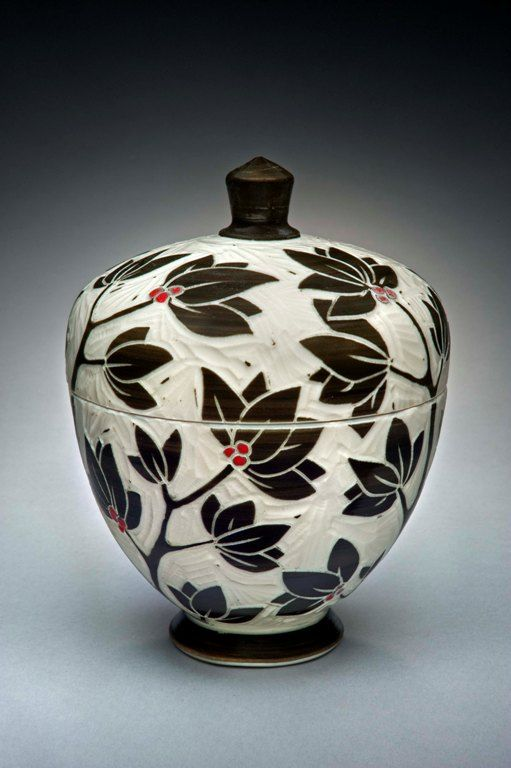 """Karen Newgard, """"I have chosen to use the sgrafitto carving technique on porcelain because it gives me a graphic quality and clarity of image. I finish the wheel thrown pots in a salt kiln that does the glazing for me and preserves the carved areas. I am influenced by many pottery traditions as well as my peers in Western North Carolina."""""""