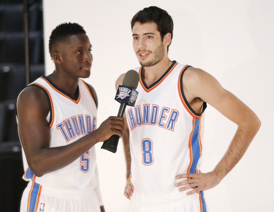 70fd10467264 Victor Oladipo interrupts a shoot of Alex Abrines to ask a question during  the Oklahoma City Thunder media day