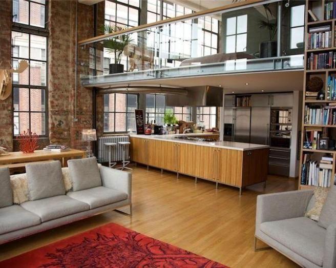 brick studio apartment. photo of split level warehouse living grey exposed brick apartment  room mezzanine studio with bookcase