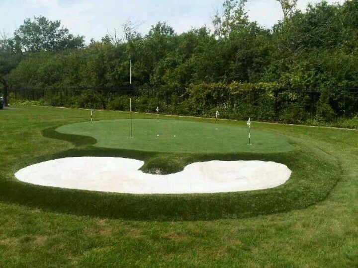 Backyard putting green with sand bunker installed by ...