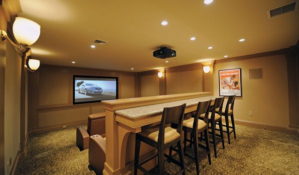 Home movie theatre complete with a bar and stools. Perfect for ...