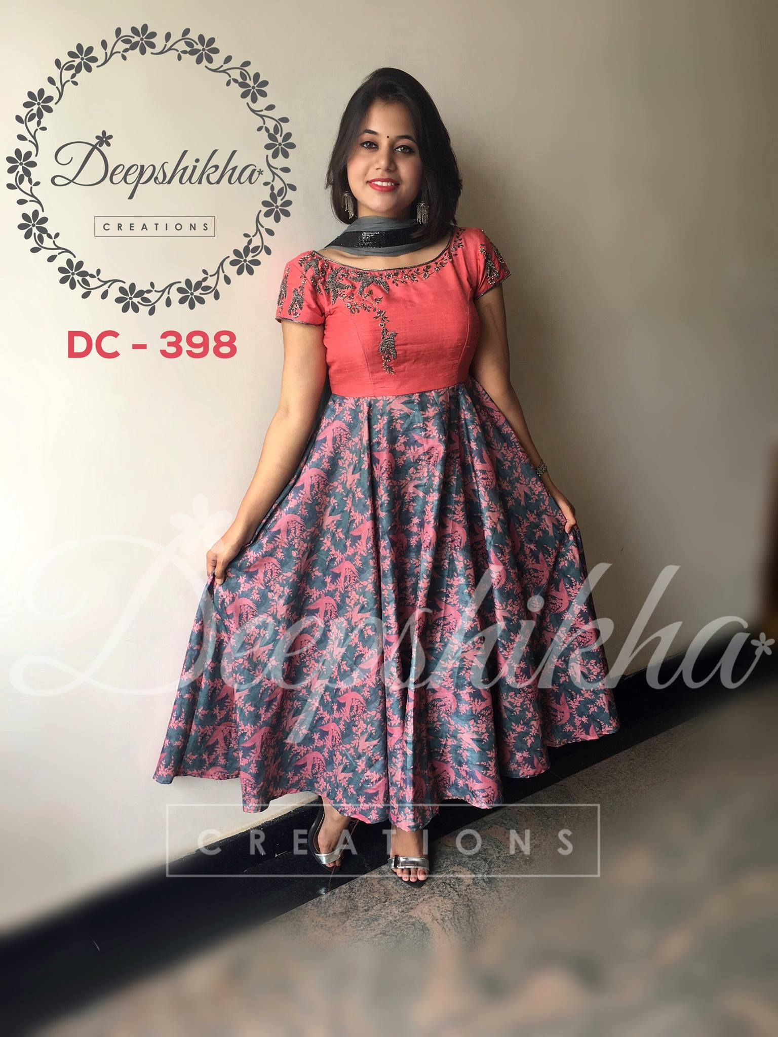 DC 398. Beautiful floor length dress with hand embroidery thread work from Deepshika.