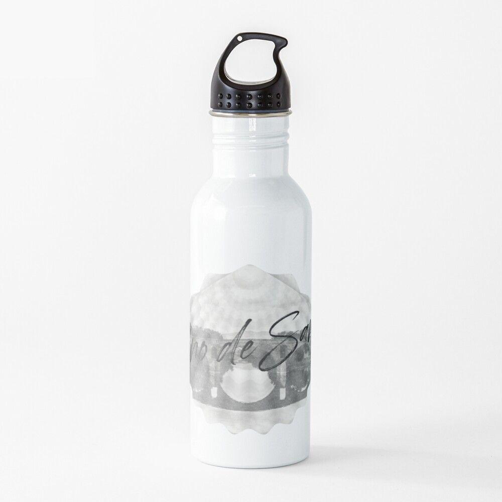 Botella de agua con una vieira del camino de Santiago