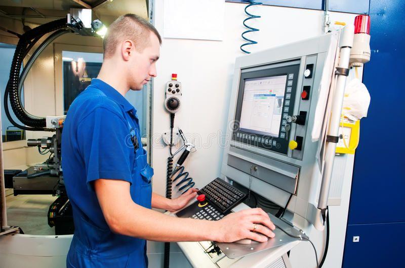 Worker operating CNC machine center. Mechanical technician ...