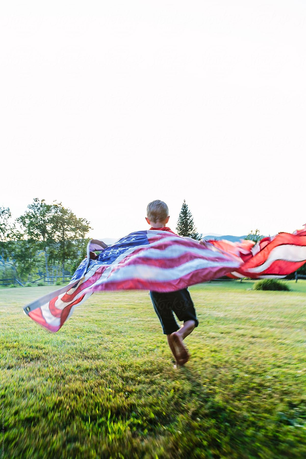 Young Boy Running With American Flag Stocksy United By Raymond Forbes Photogr Children Photography Poses Photography Inspiration Creative Running Photography